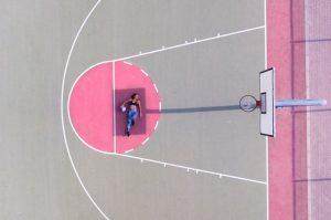 Girl resting on court
